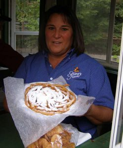 Woman at Grant's Farm serves funnel cake