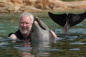 Robert Scheer with Scarlet the dolphin